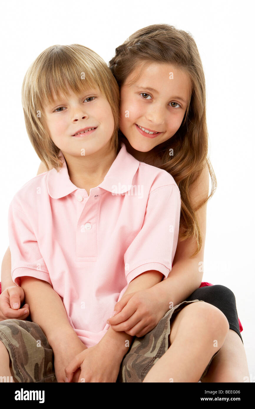 Two Children Sitting with each other in Studio - Stock Image