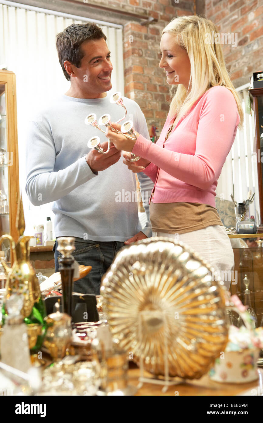 Couple shopping for antiques - Stock Image