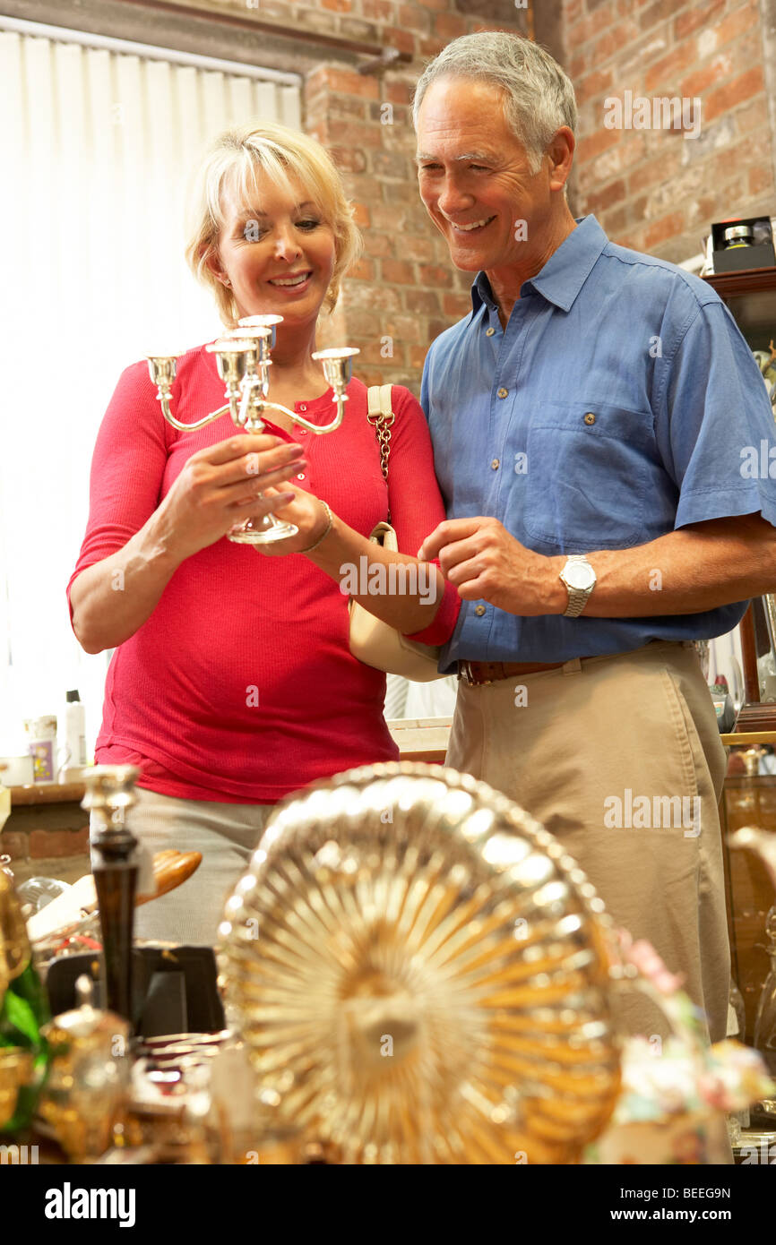 Middle aged couple shopping for antiques - Stock Image