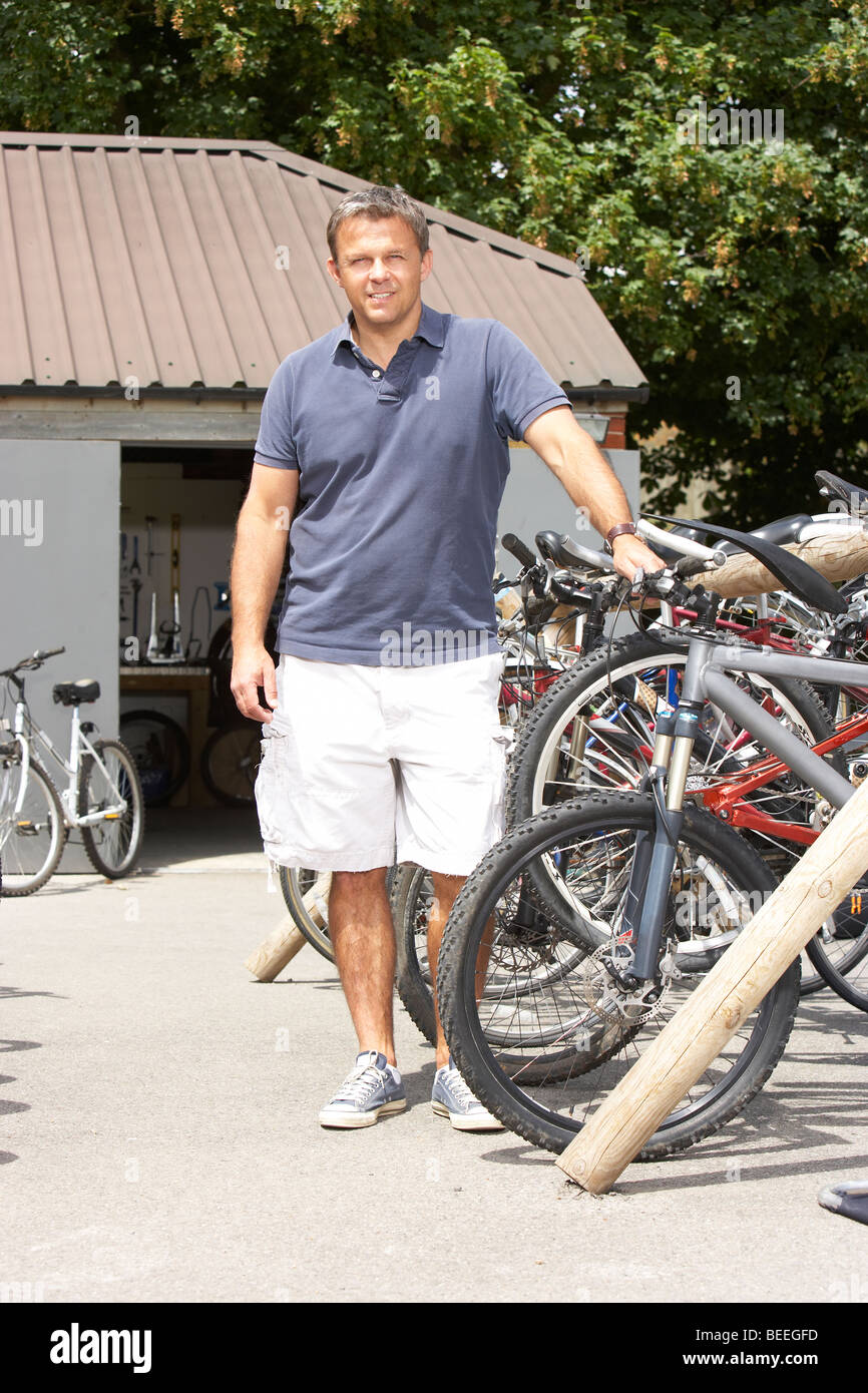 Owner of cycle shop in workshop - Stock Image