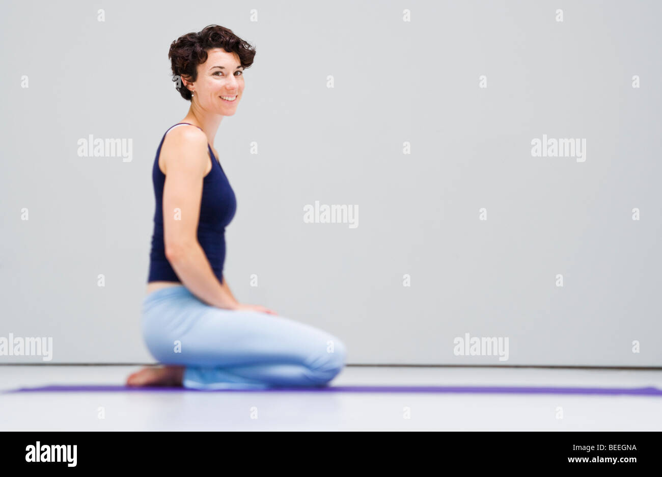 Portrait of young woman in a yoga studio. - Stock Image