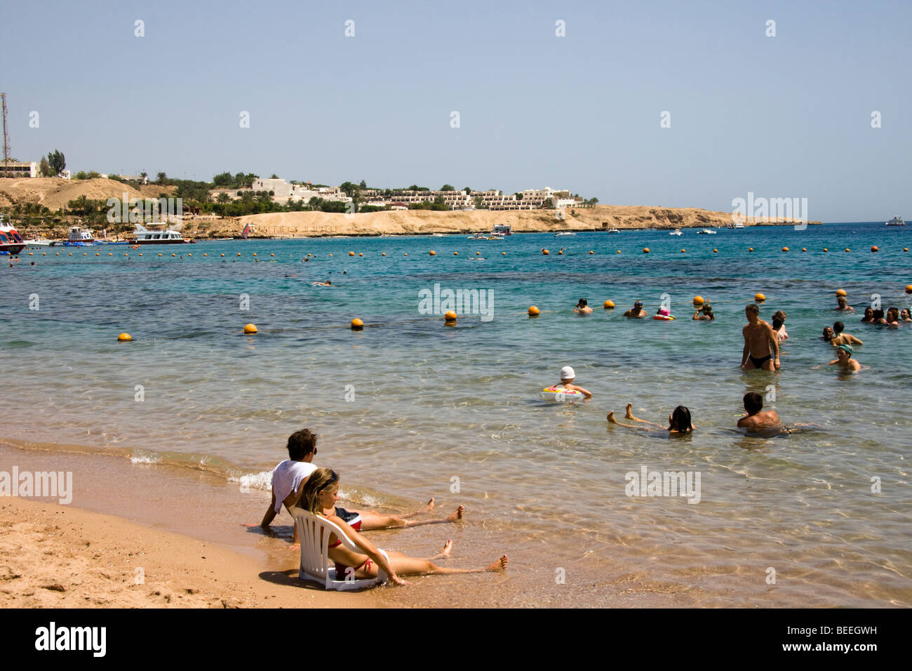 Tourists Enjoying The Sun At Naama Bay Beach Sharm El Sheikh Red Stock Photo Alamy