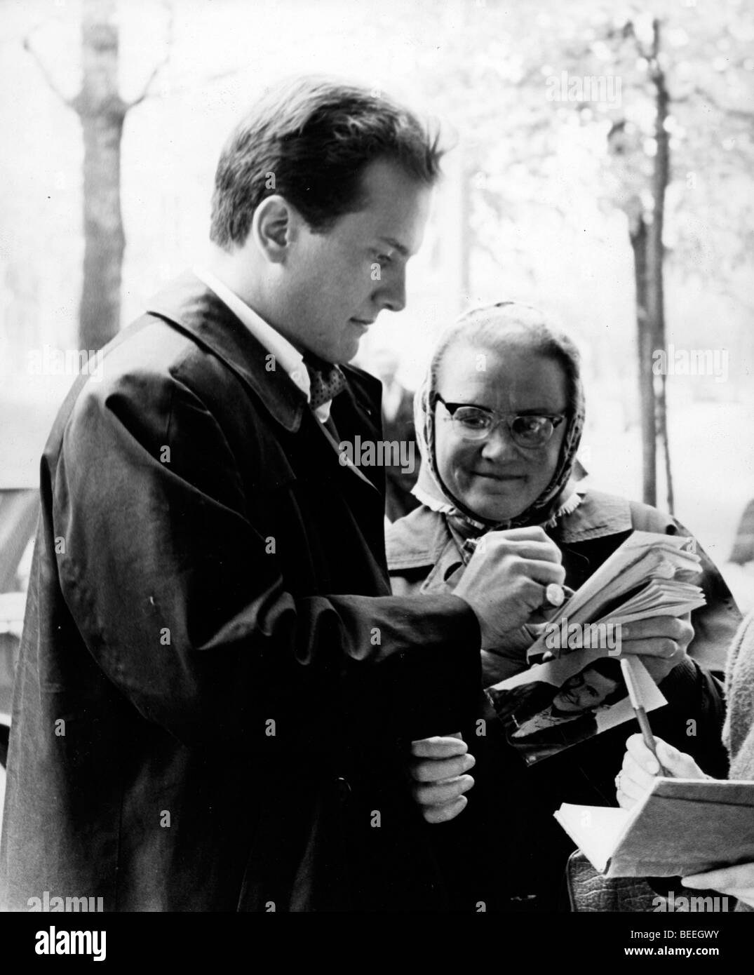 Singer PAT BOONE signs a autograph for a fan in the late 1950's. Stock Photo