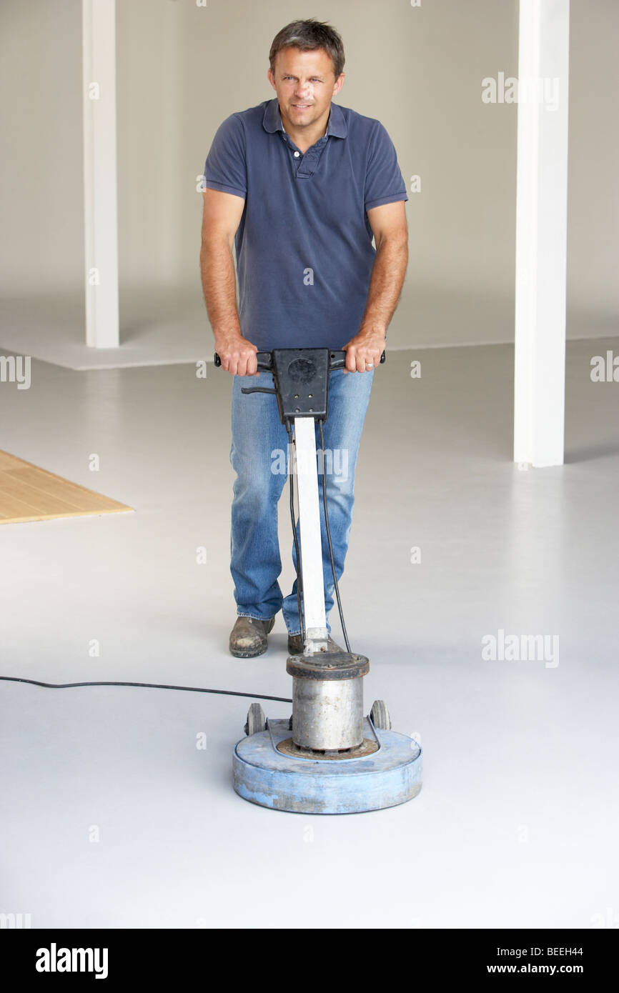 Cleaner polishing office floor - Stock Image
