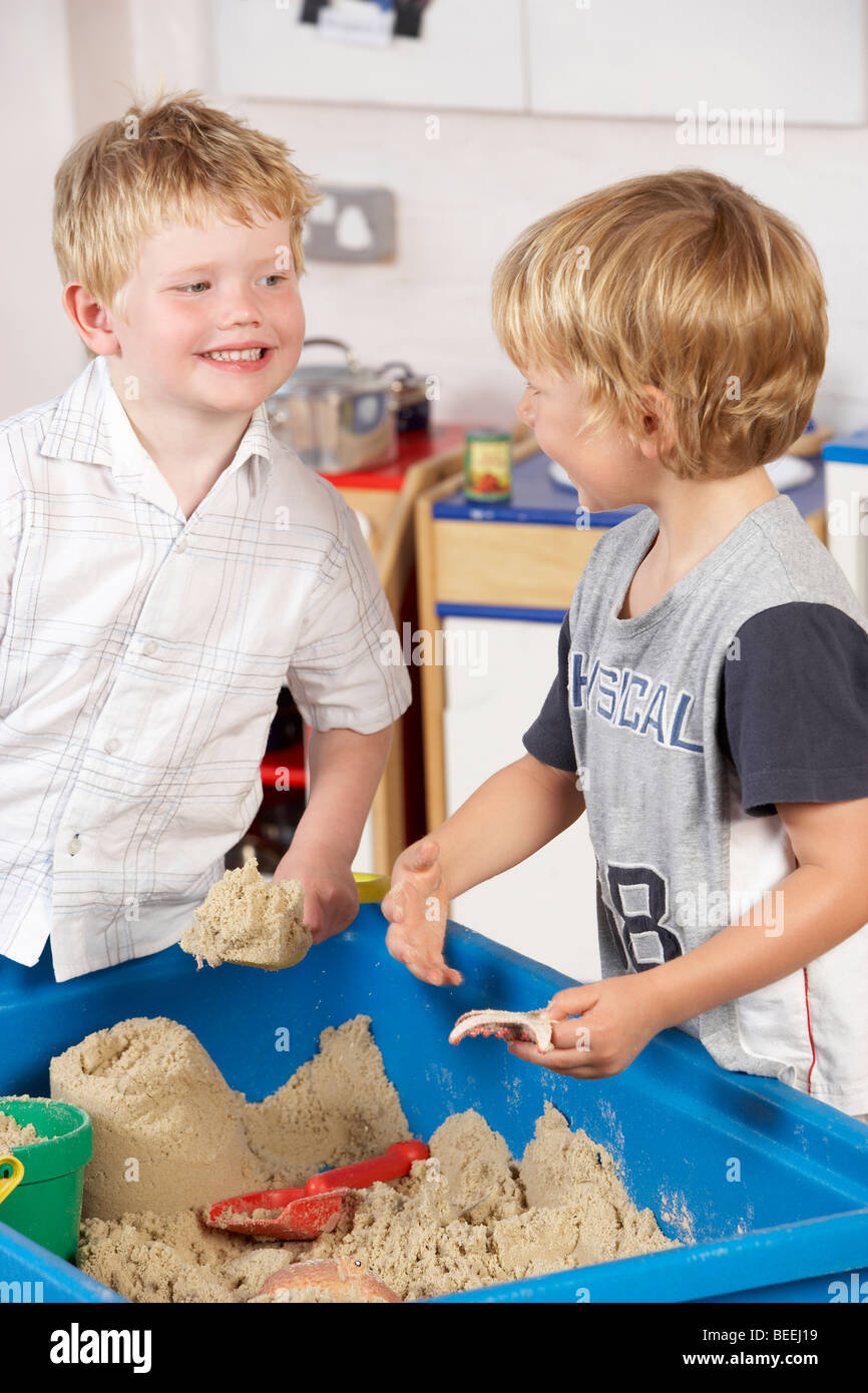 Two Young Children Playing Together at Montessori/Pre-School - Stock Image