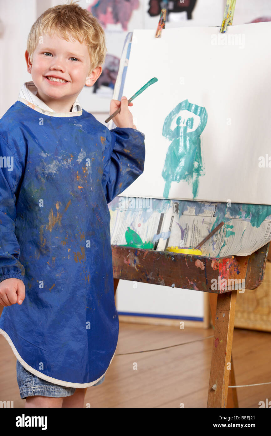 Young Boy Painting - Stock Image