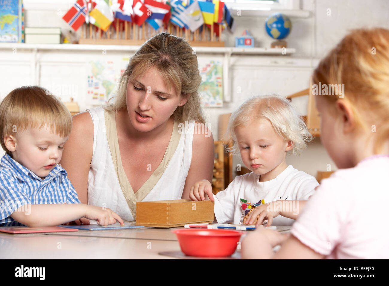 Young Boy Playing at Montessori/Pre-School - Stock Image