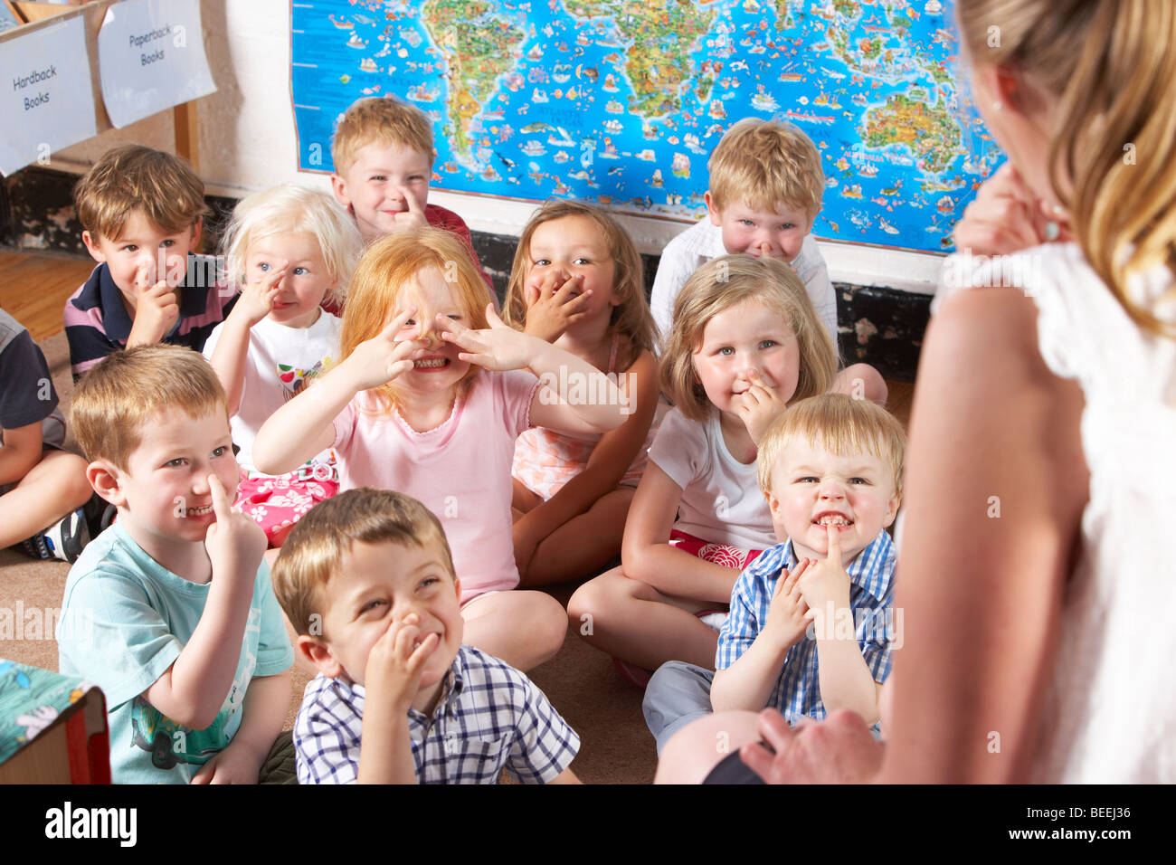 Montessori/Pre-School Class Listening to Teacher on Carpet - Stock Image