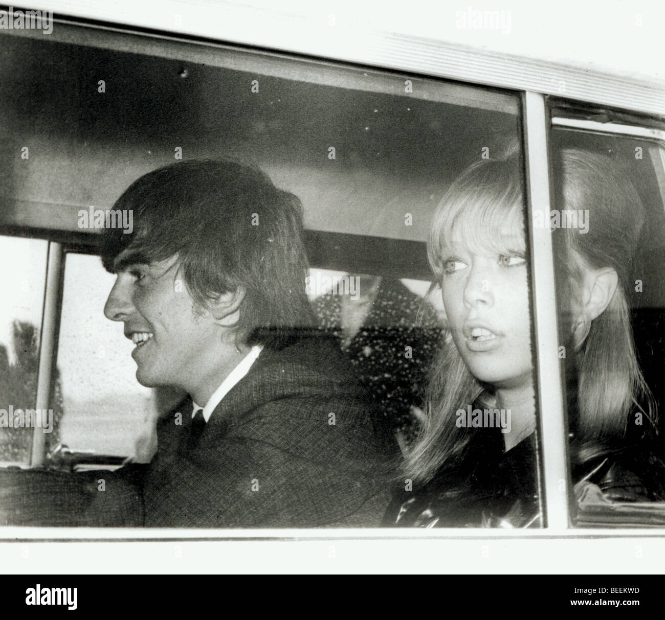 Beatle George Harrison and wife Pattie Boyd returning from the airport - Stock Image