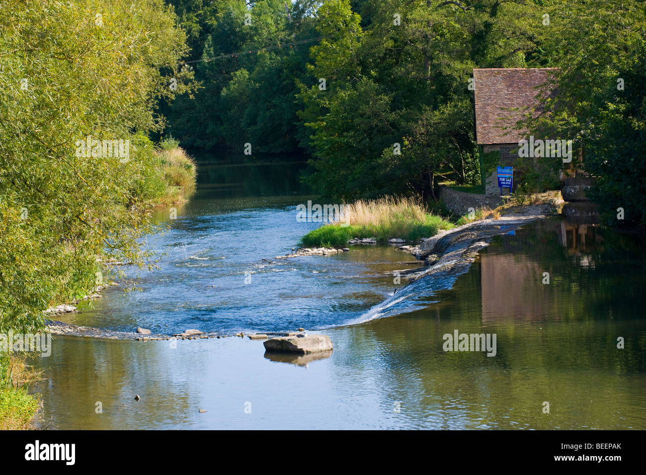 View down River Teme with old mill house for sale Ludlow Shropshire England UK - Stock Image