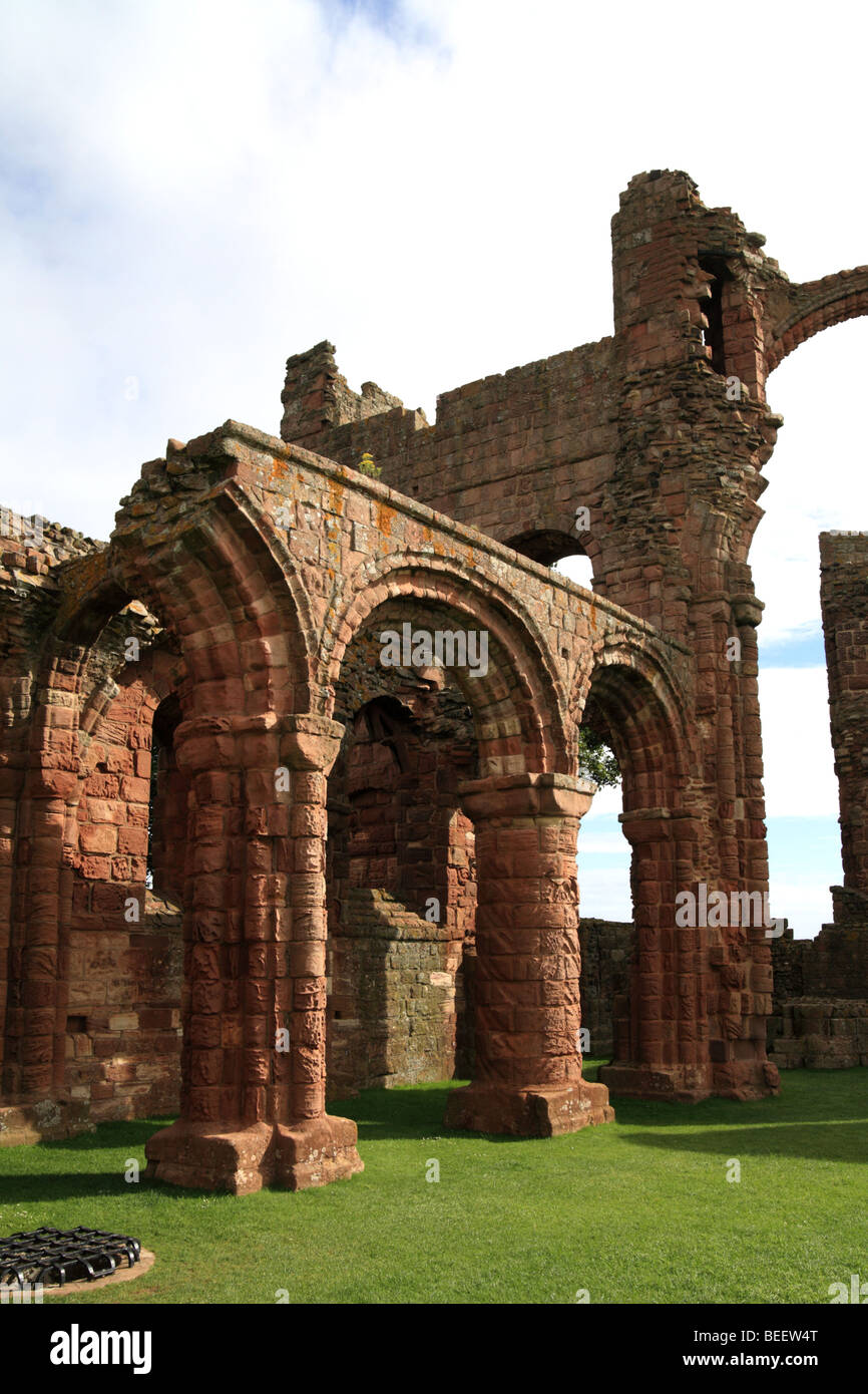 'Lindisfarne priory' ruin, St Cuthbert burial place, English Heritage, Holy Island, Northumberland, UK - Stock Image