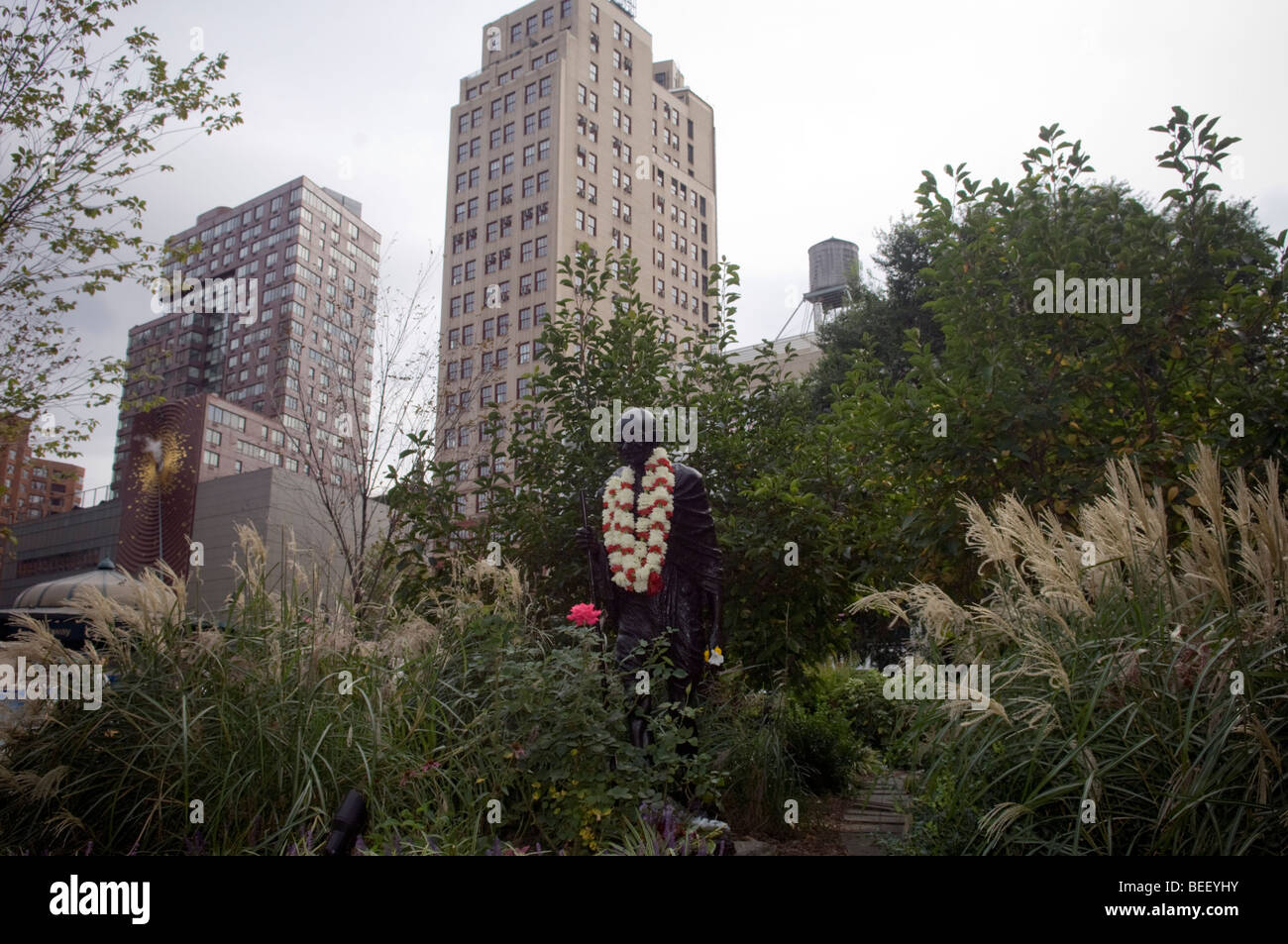 The Mahatma Gandhi statue in New York is hung with garlands on Friday, October 2, 2009 for his birthday - Stock Image