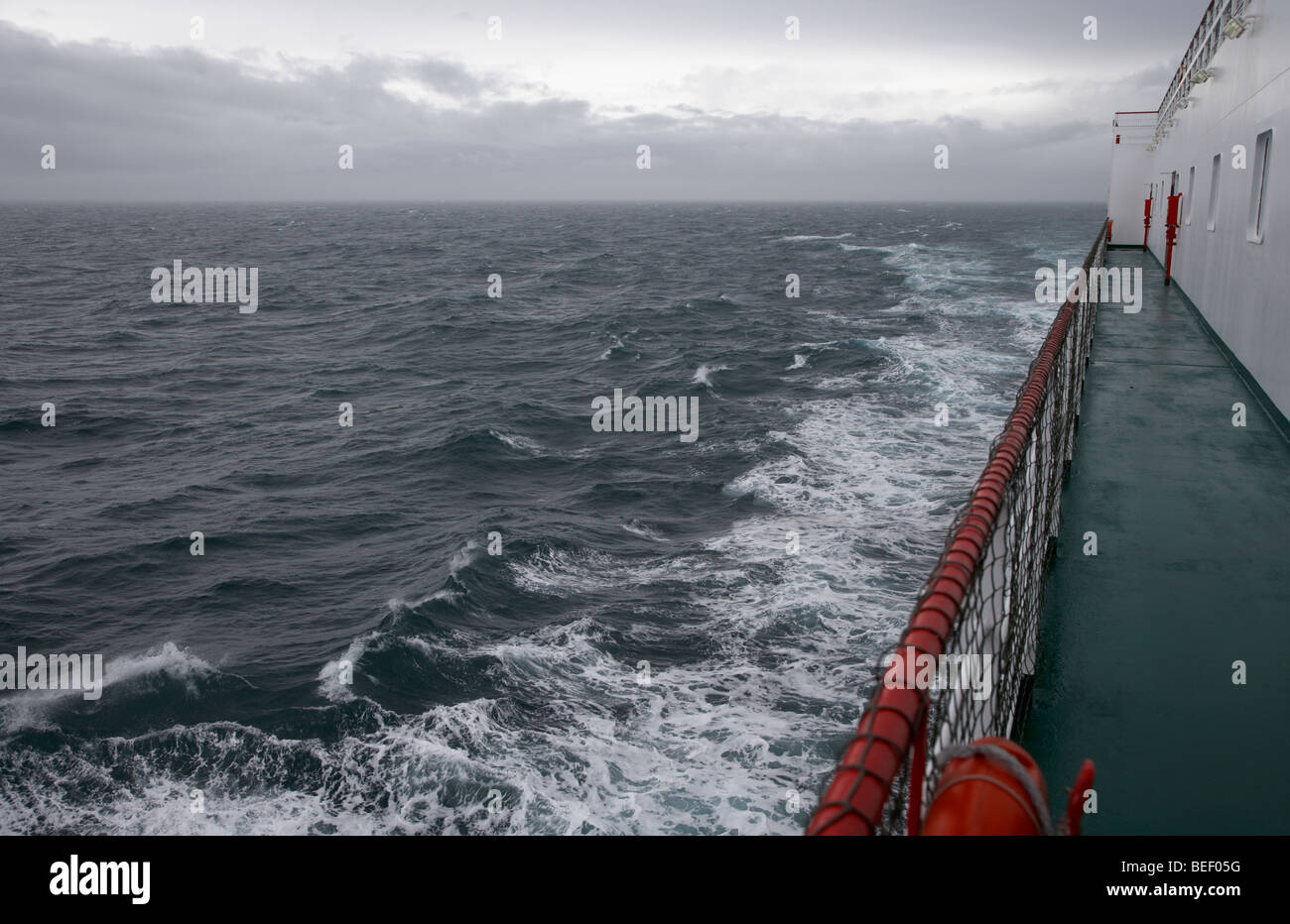 On board the mersey viking belfast liverpool ferry on a dull grey day with rough seas - Stock Image