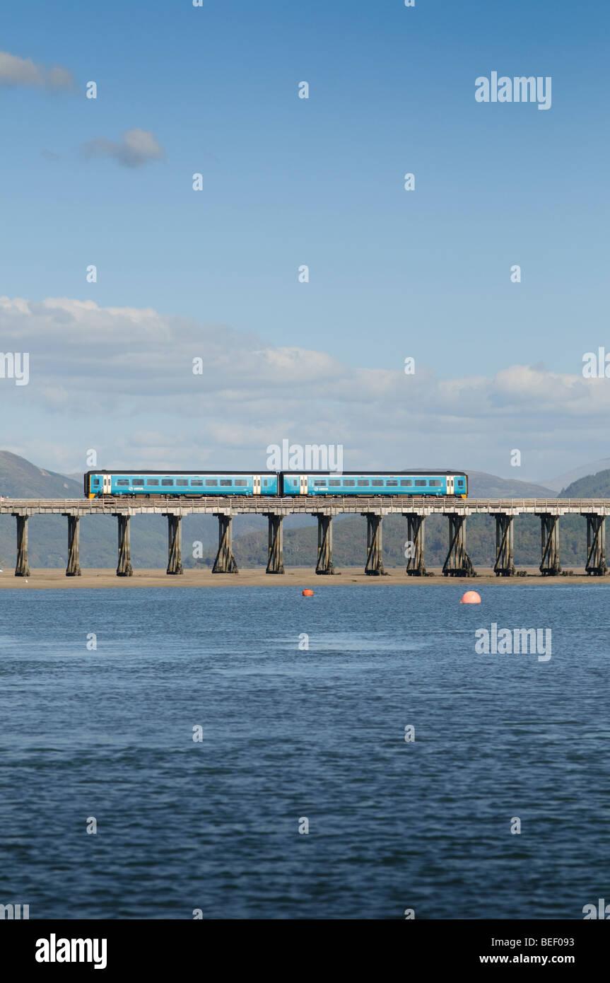 ARRIVA Wales train crossing the wooden, bridge over the Mawddach Estuary, Snowdonia National Park, Gwynedd, North Stock Photo