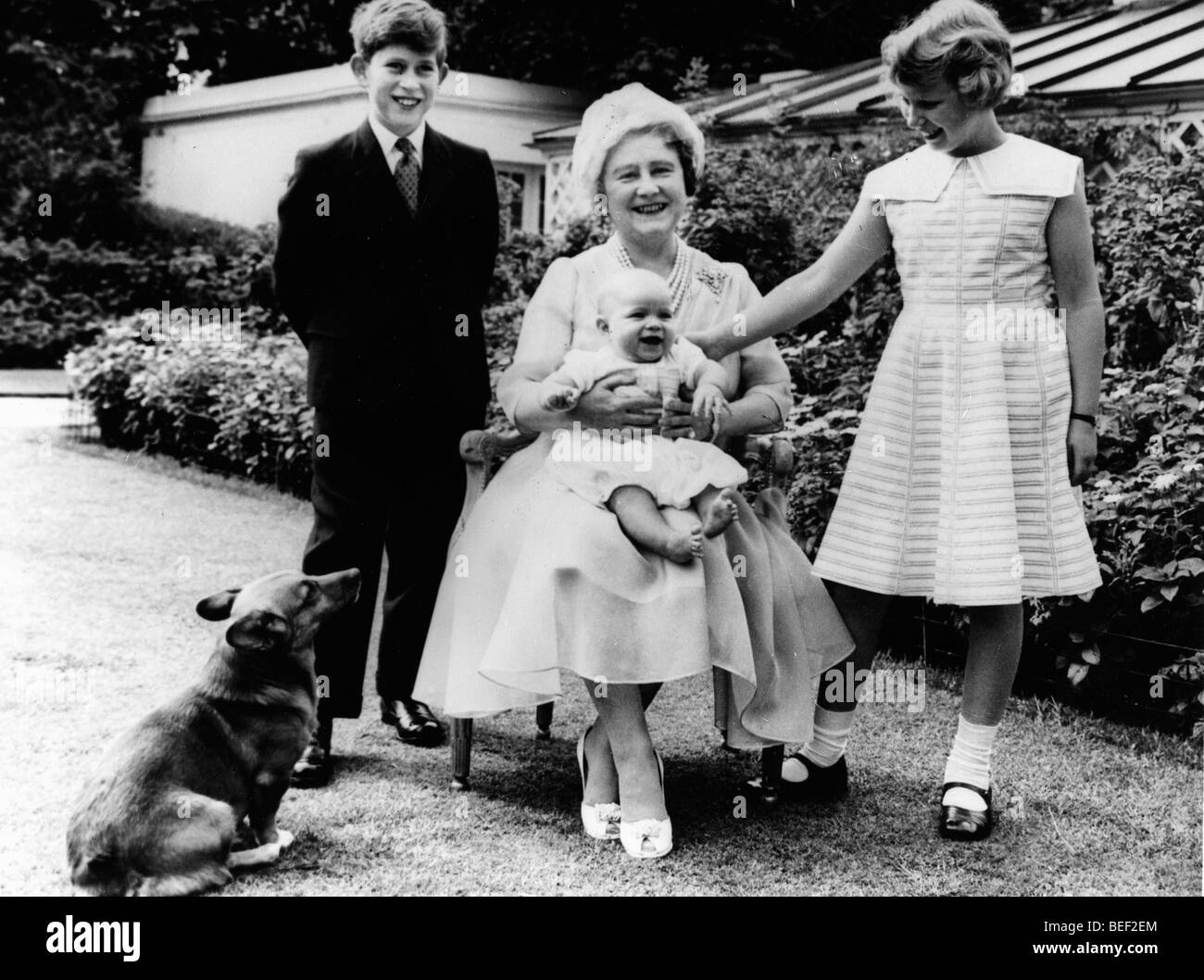 The Queen Mother, Elizabeth Bowes-Lyon, with her grandchildren Prince Charles, Princess Anne, and Prince Andrew Stock Photo