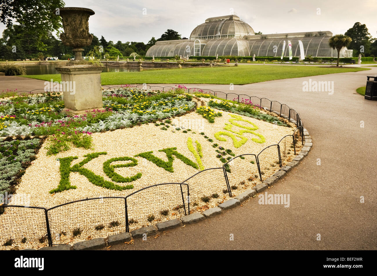 A flowerbed with the writing 'Kew 250th' in green plants. - Stock Image