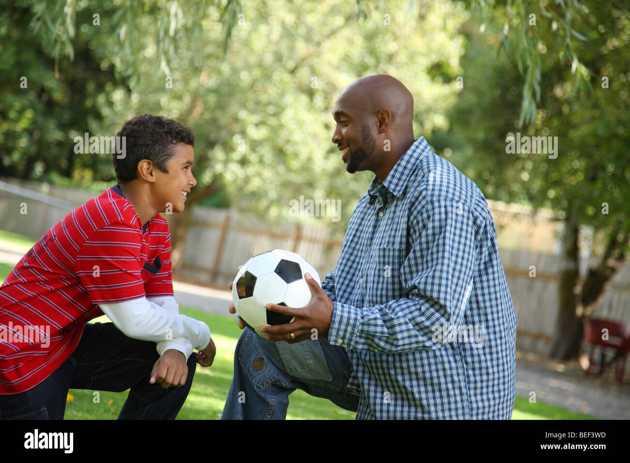Father and son with soccer ball - Stock Image