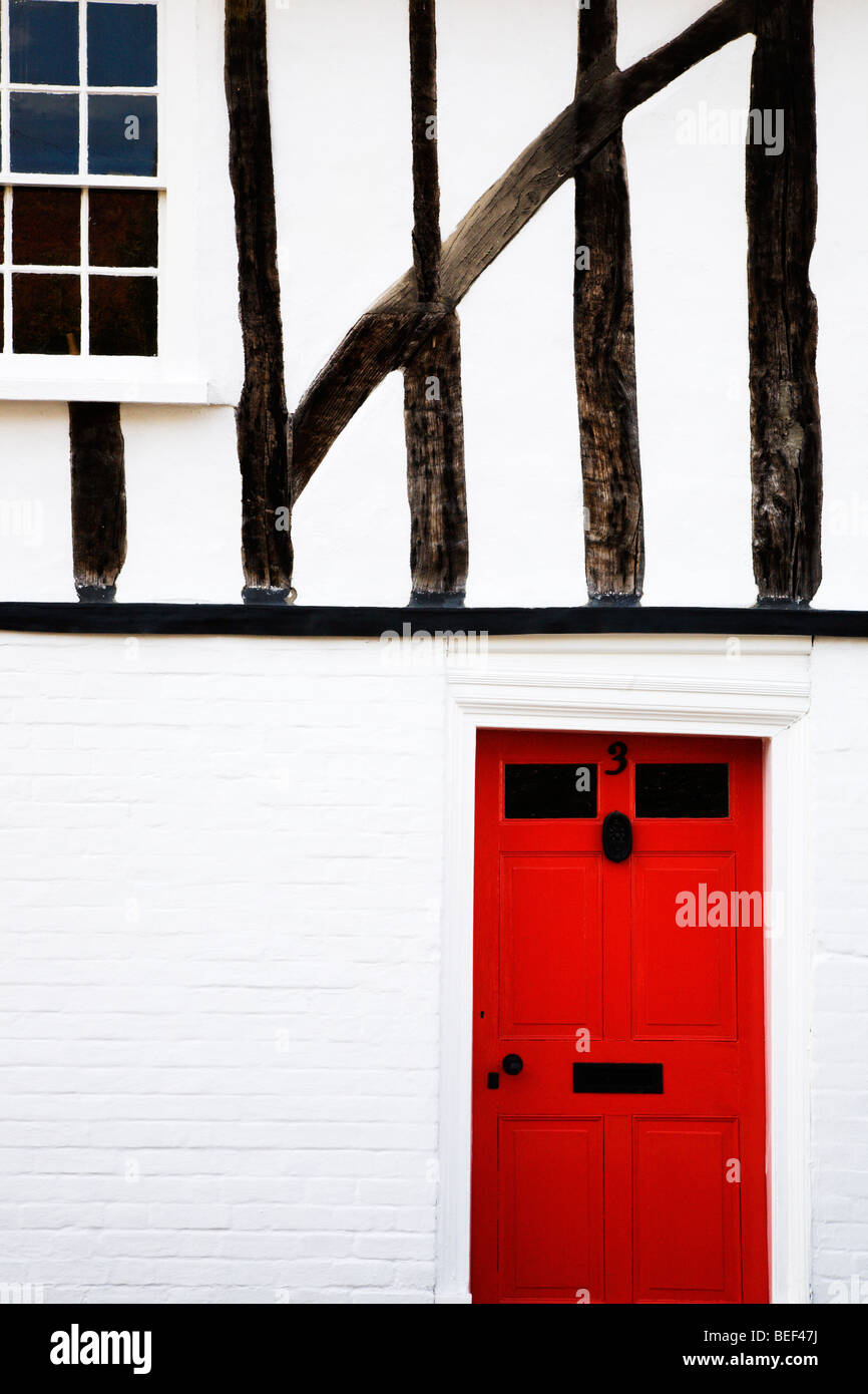 Red Door in Half Timbered House Nayland Suffolk England Stock Photo