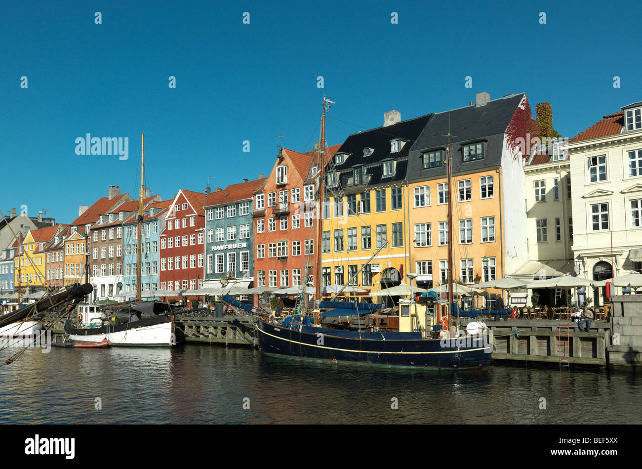 Ships are pictured in Nyhavn, Copenhagen, Denmark in front of colorful buildings on August 6, 2009. Stock Photo