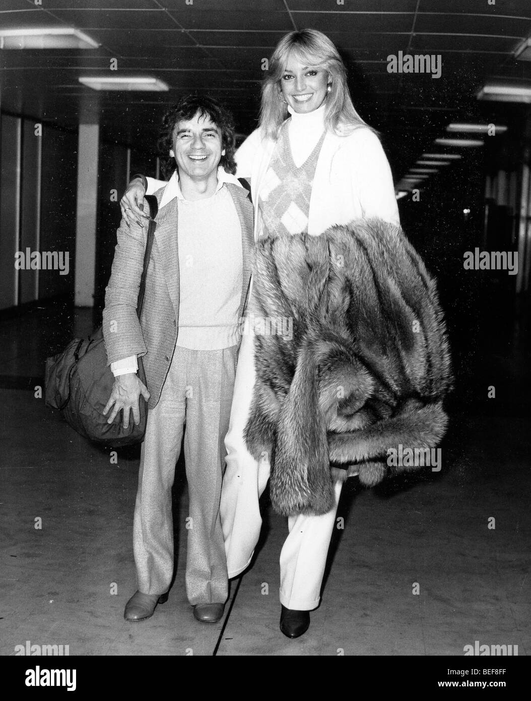 Oct 01, 1980; London, UK; Actor DUDLEY MOORE (April 19, 1935 - March 27, 2002) and his girlfriend SUSAN ANTON arriving - Stock Image
