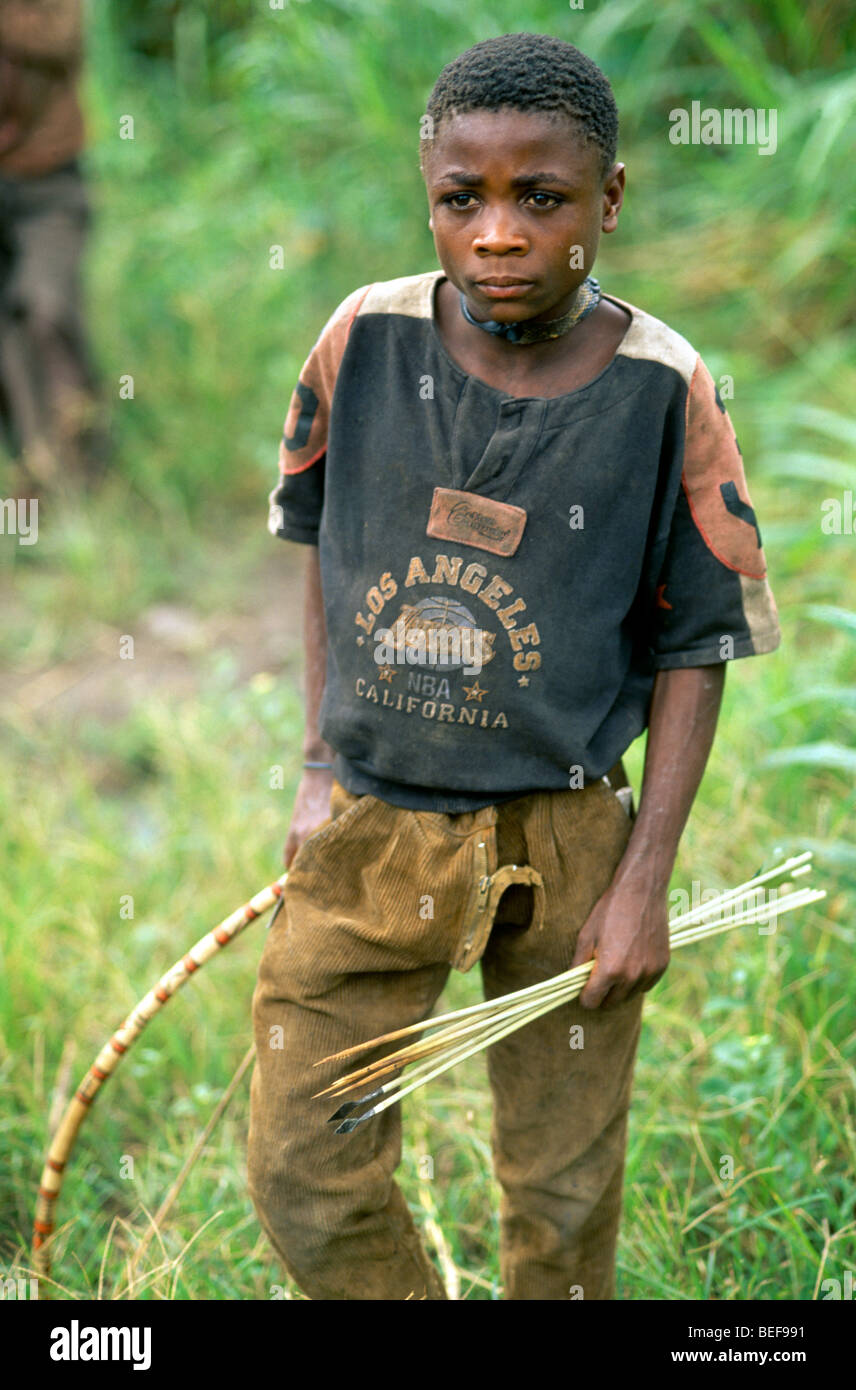 Pygmy Child with Traditional Weapons, Bow and Arrows, Seliki Valley, Uganda, Africa - Stock Image