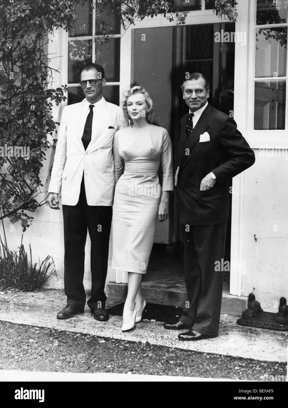 Actor LAURENCE OLIVER, Actress MARILYN MONROE (aka Norma Jean) and husband ARTHUR MILLER - Stock Image