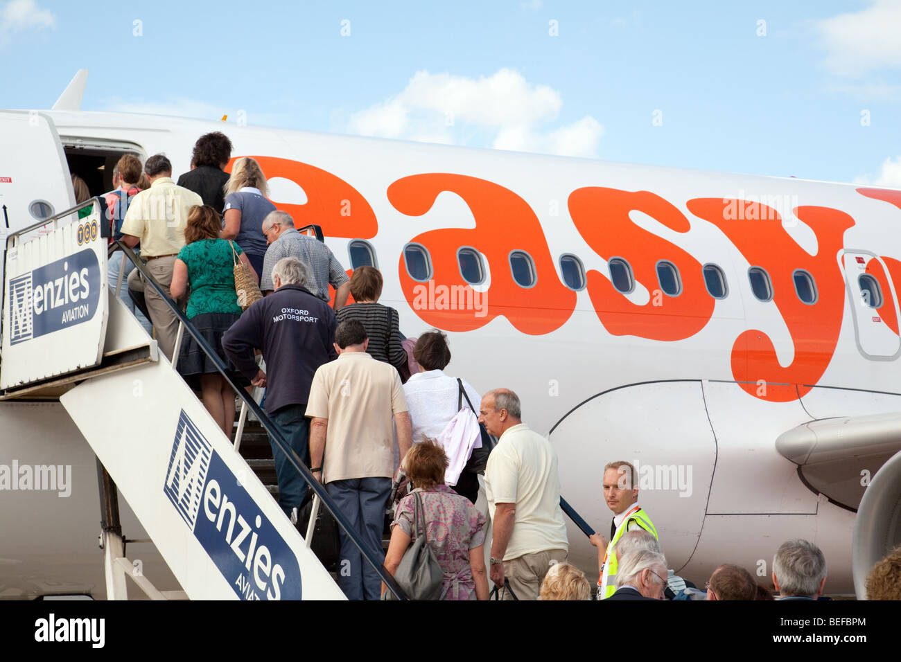 Passengers boarding an Easyjet plane at Stansted airport, UK - Stock Image