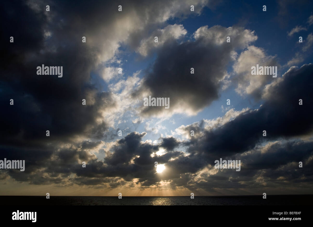 Cloudy early morning sky over the sea - Stock Image