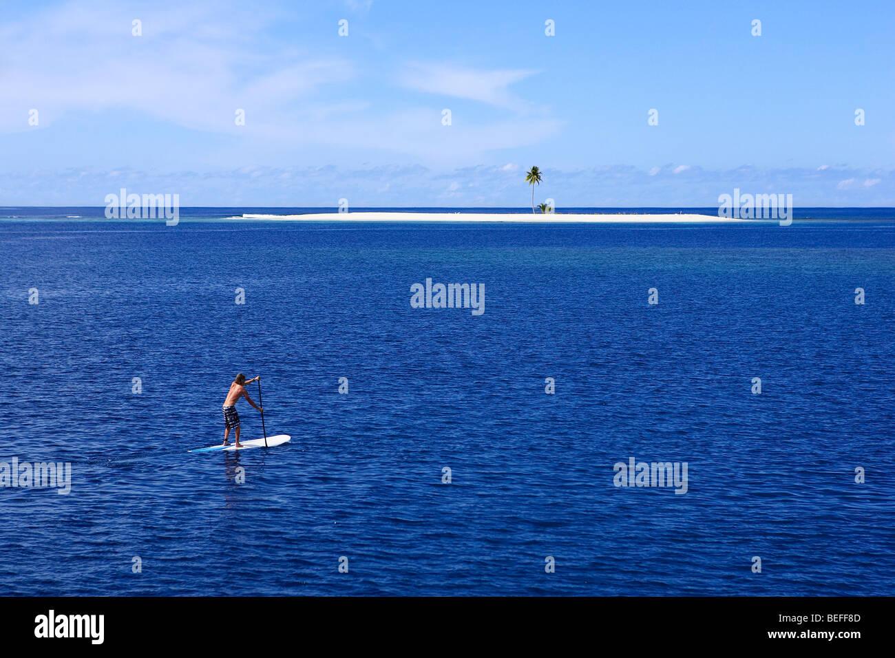 Paddle boarding to sand Island - Stock Image