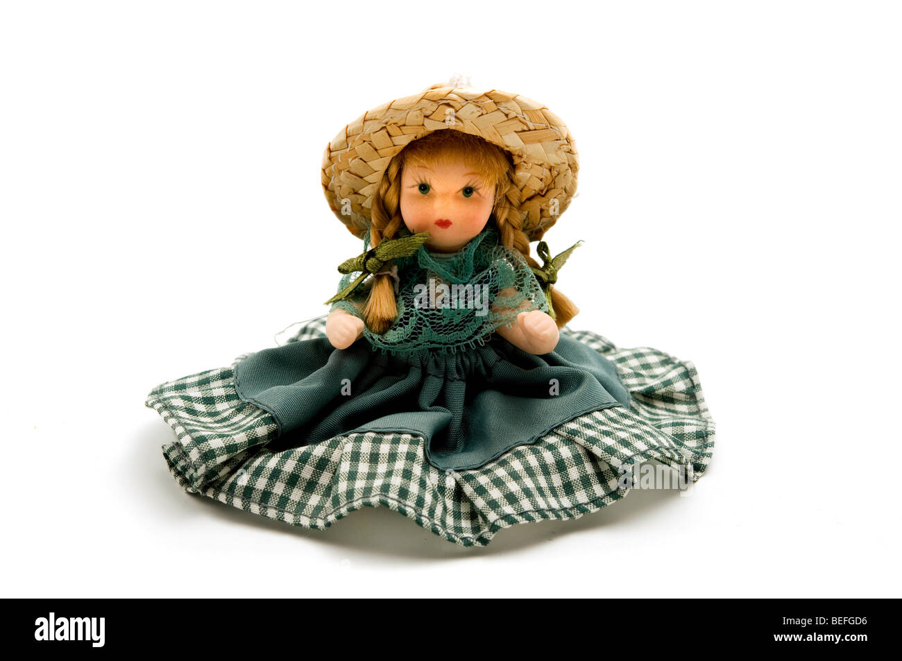 Old porcelain doll on a white background - Stock Image