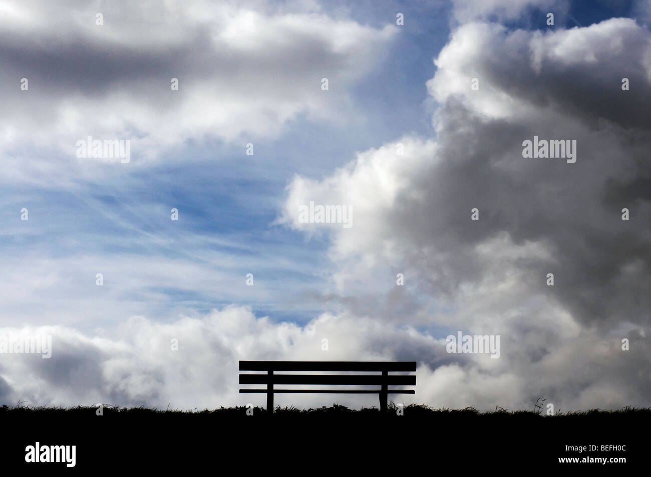Bench with a dramatic sky - Stock Image