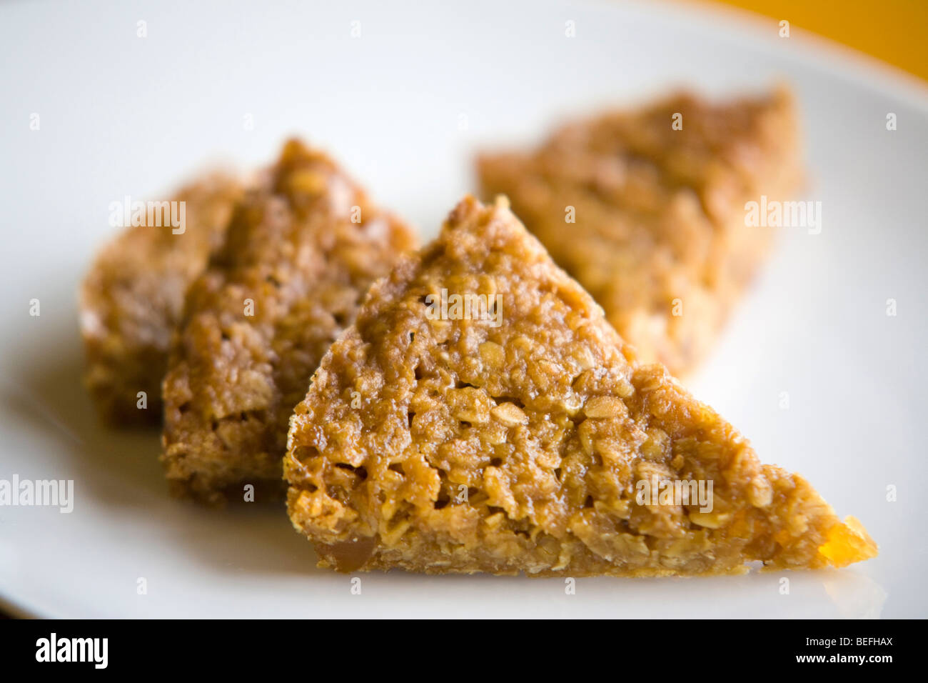 A flap jack on a plate - Stock Image