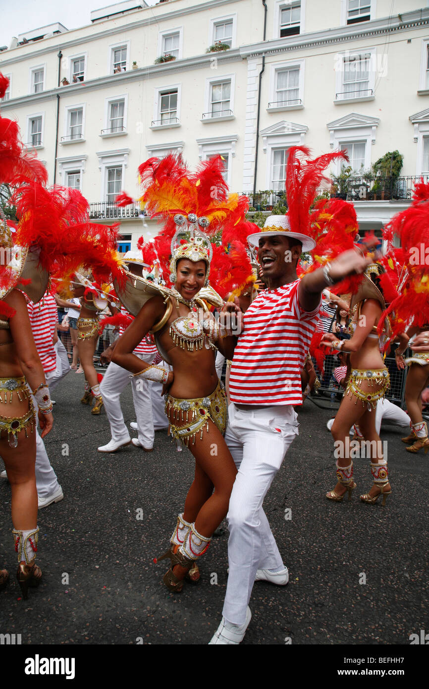 Costume parade at Notting Hill Carnival on Wesbourne Grove, Notting Hill, London, UK - Stock Image