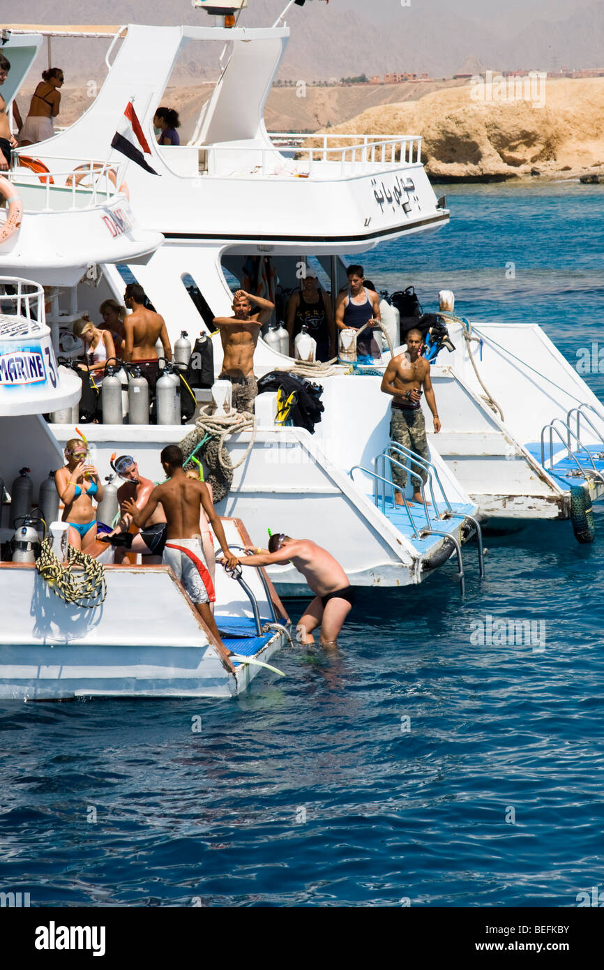 Scuba diving boats and snorkellers, Sharm el Sheikh, Red Sea, Egypt - Stock Image