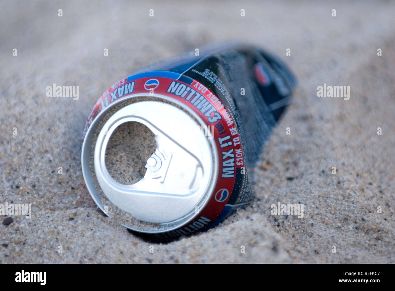 Discarded can on Beach - Stock Image