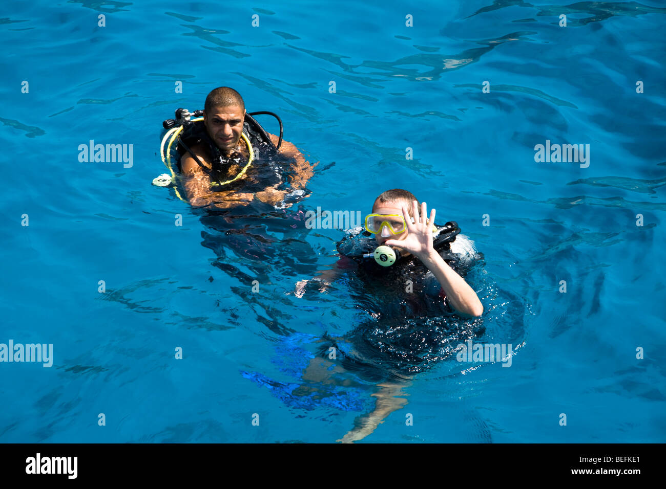Scuba divers, Sharm el Sheikh, Red Sea, Egypt - Stock Image