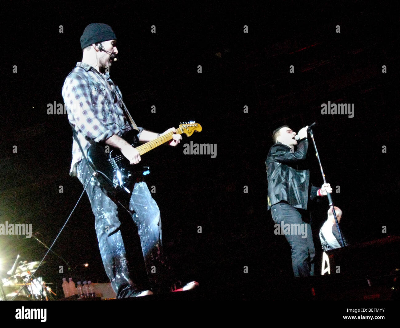 The Edge, guitarist of the Irish rock band U2, performs live with vocalist Bono and bassist Adam Clayton during - Stock Image