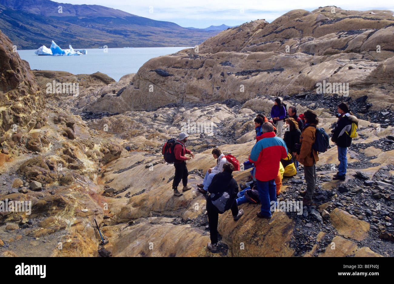 A guide gives instructions to a group of of tourists before beginning a trekking on the glacier Viedma. El Chalten. Stock Photo