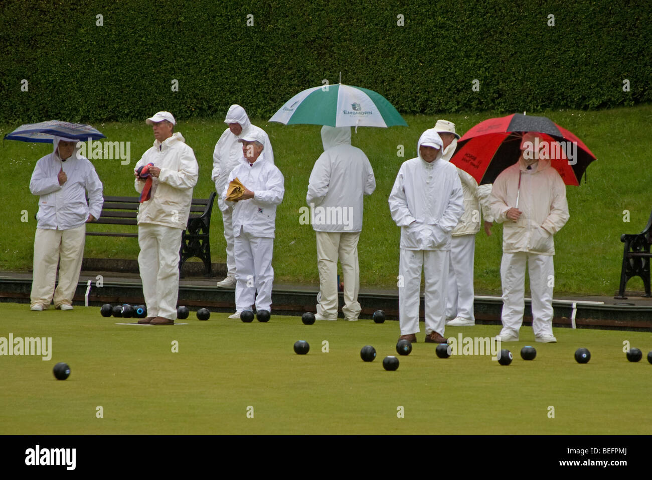 Lawn Bowls Played in Rain - Stock Image
