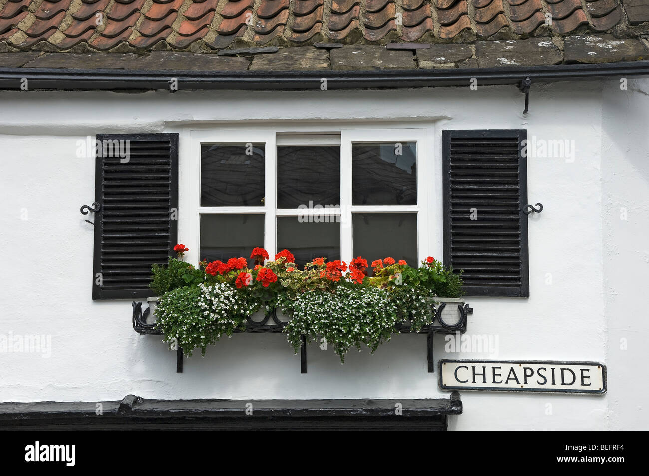 Shutters and window box on cottage England UK United Kingdom GB Great Britain - Stock Image