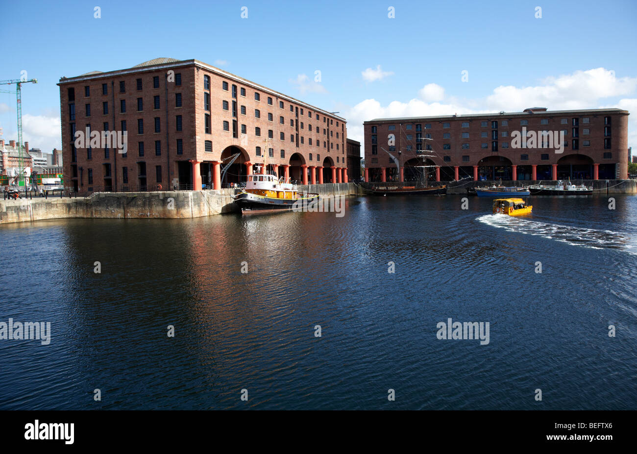warehouses housing the maritime museum in the basin at the albert dock liverpool merseyside england uk - Stock Image