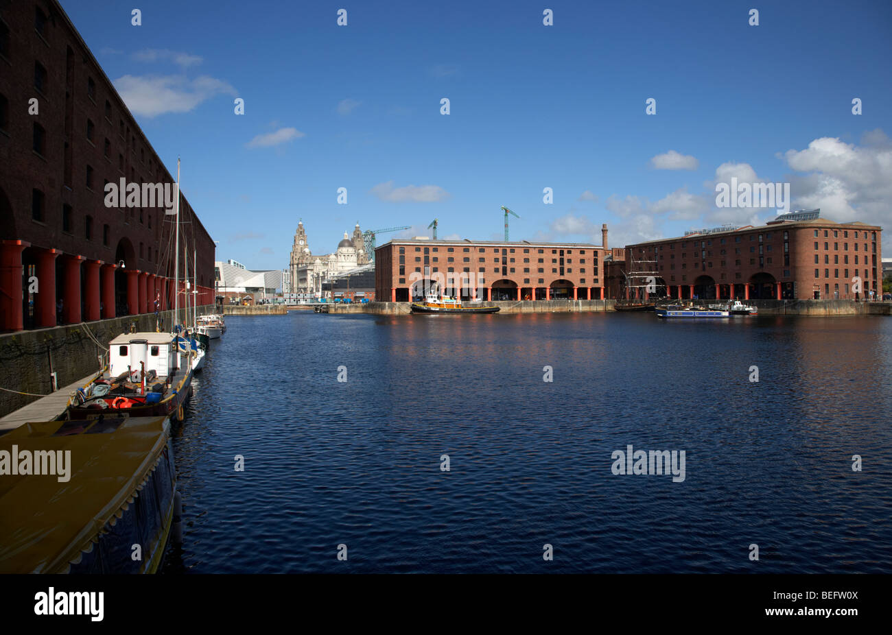 historic warehouses in the basin area at the albert dock liverpool merseyside england uk Stock Photo