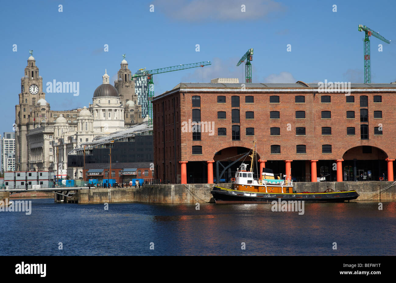 historic warehouses in the basin area at the albert dock liverpool merseyside england uk - Stock Image