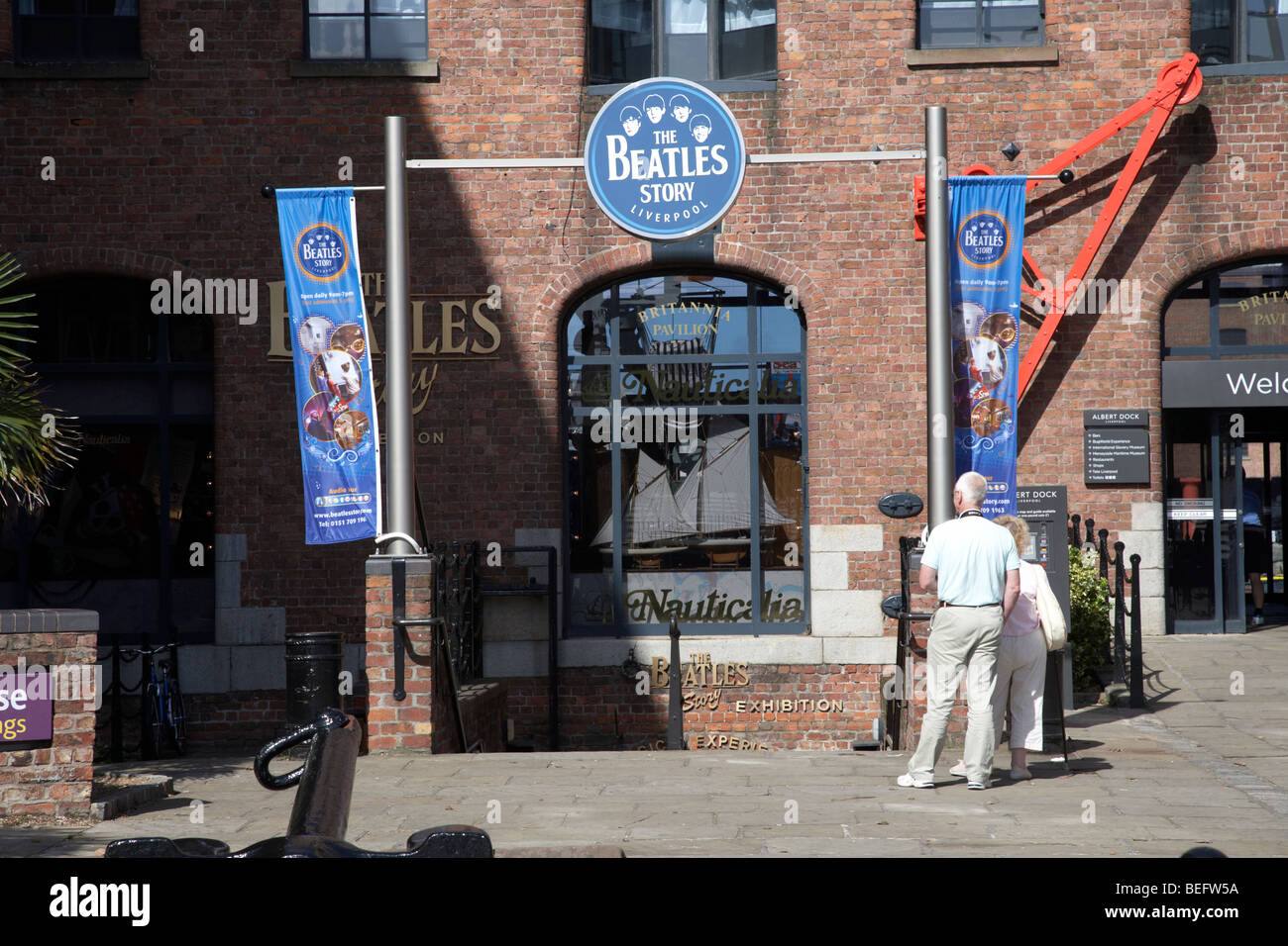 tourists at the beatles story exhibition at the albert dock liverpool merseyside england uk - Stock Image