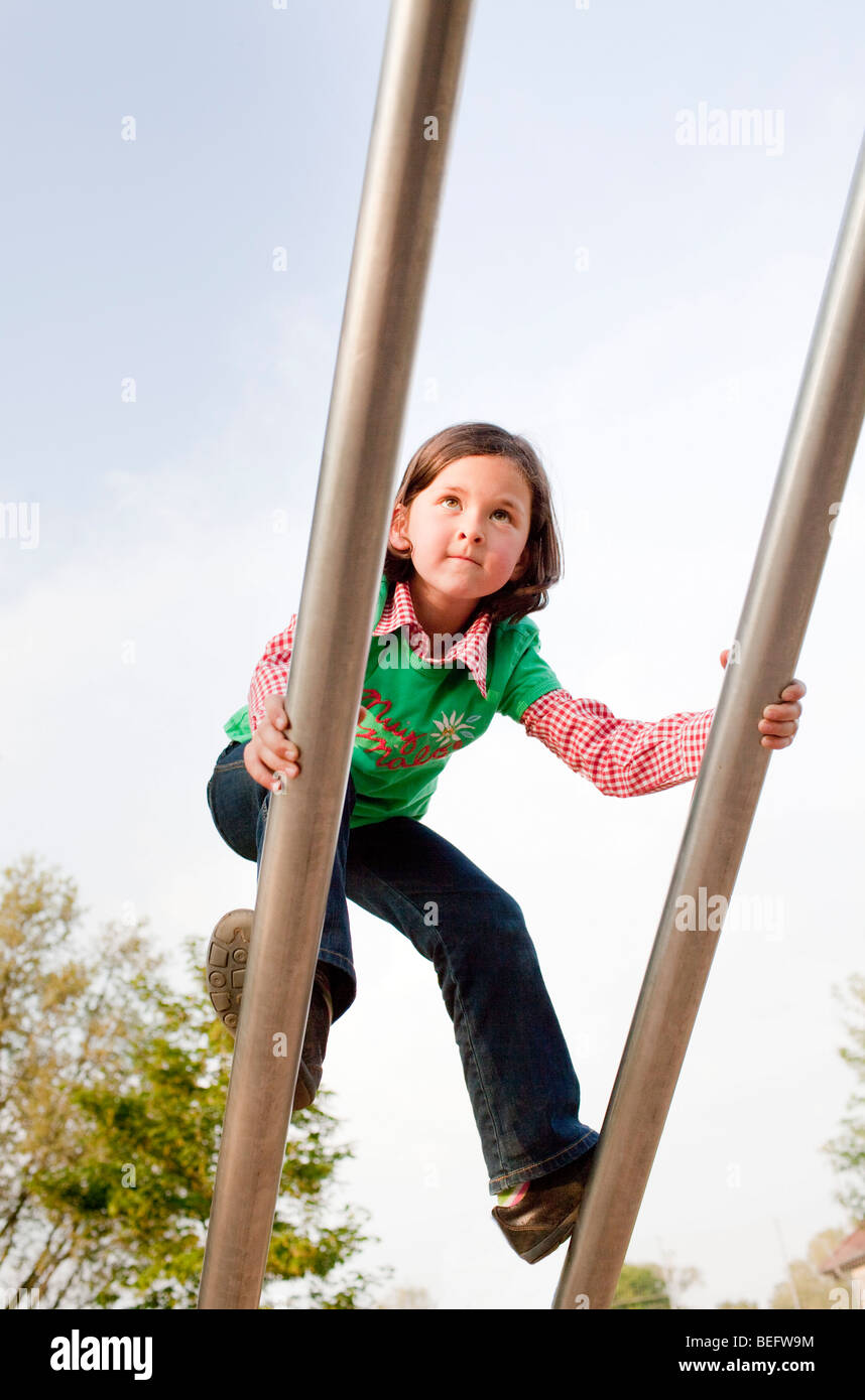 A girl is playing at a plyground - Stock Image
