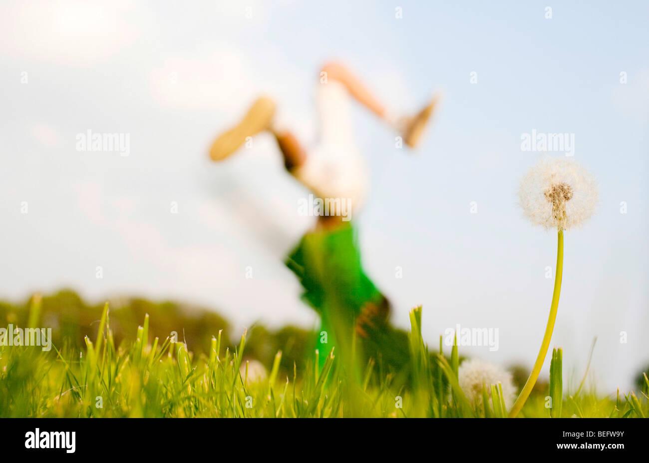 Boy doing handstand. - Stock Image