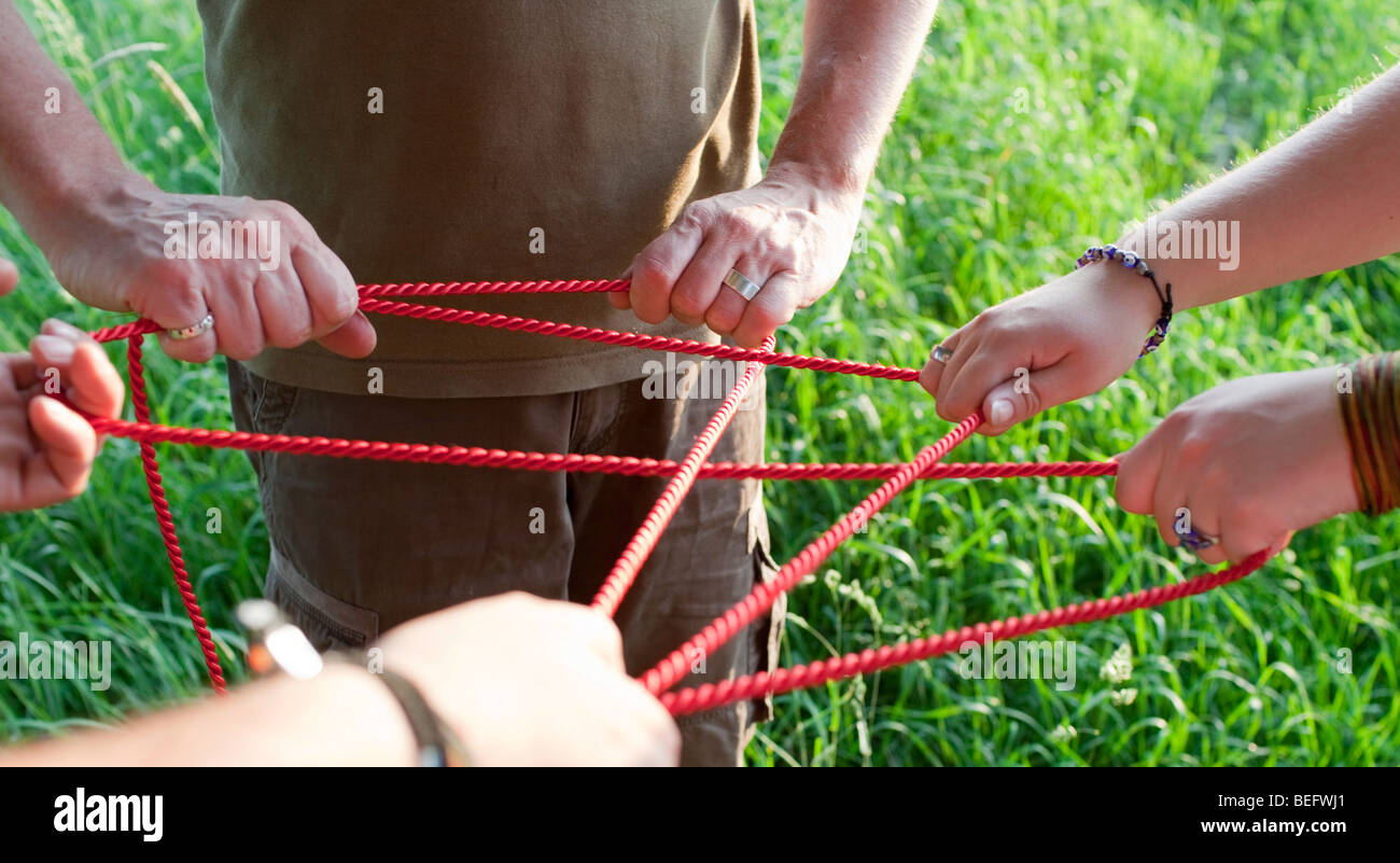People creating network with ropes . - Stock Image