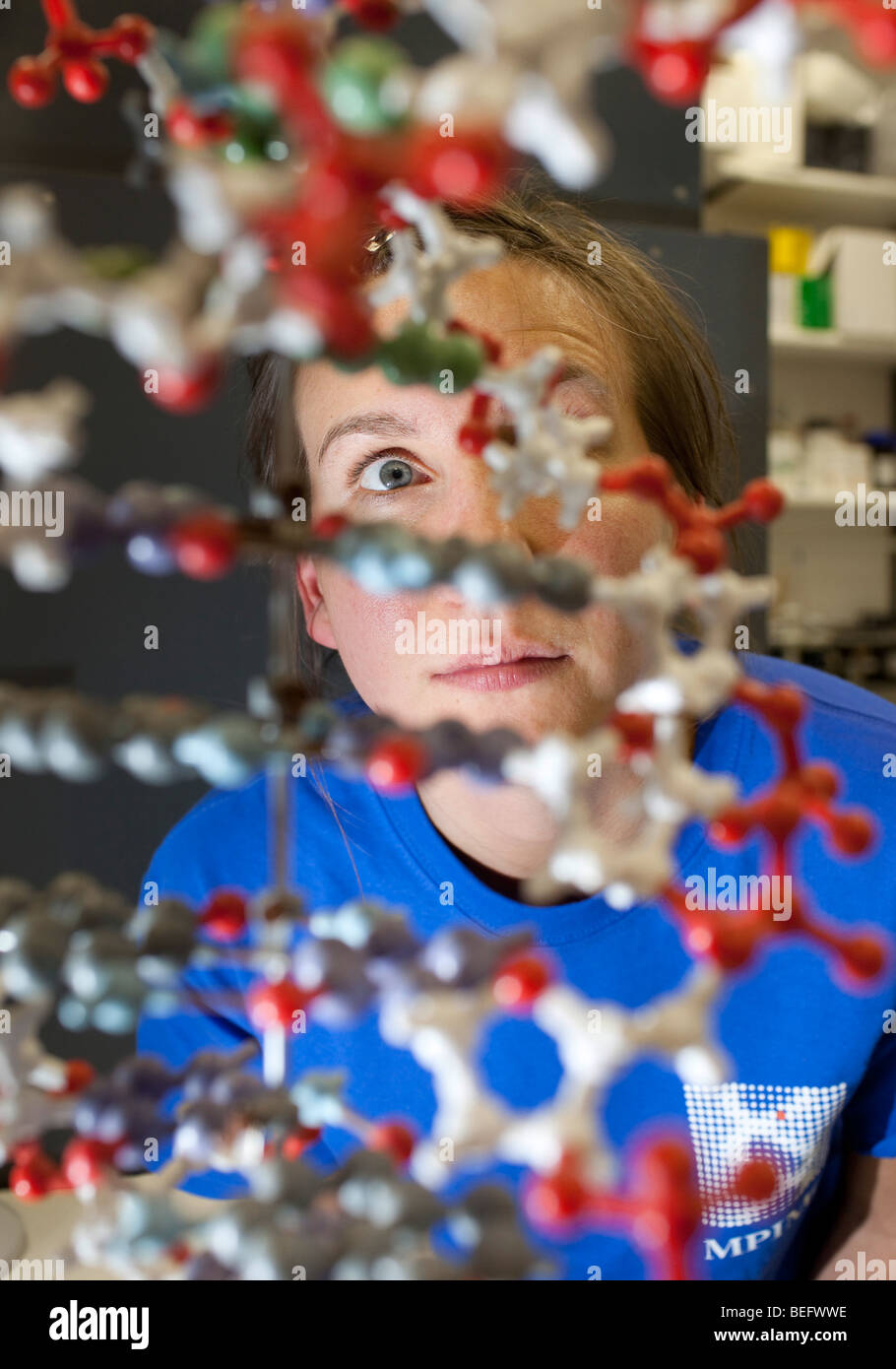 Student sitting behind a DNA Model at the Max-Planck-Institue at Berlin - Stock Image