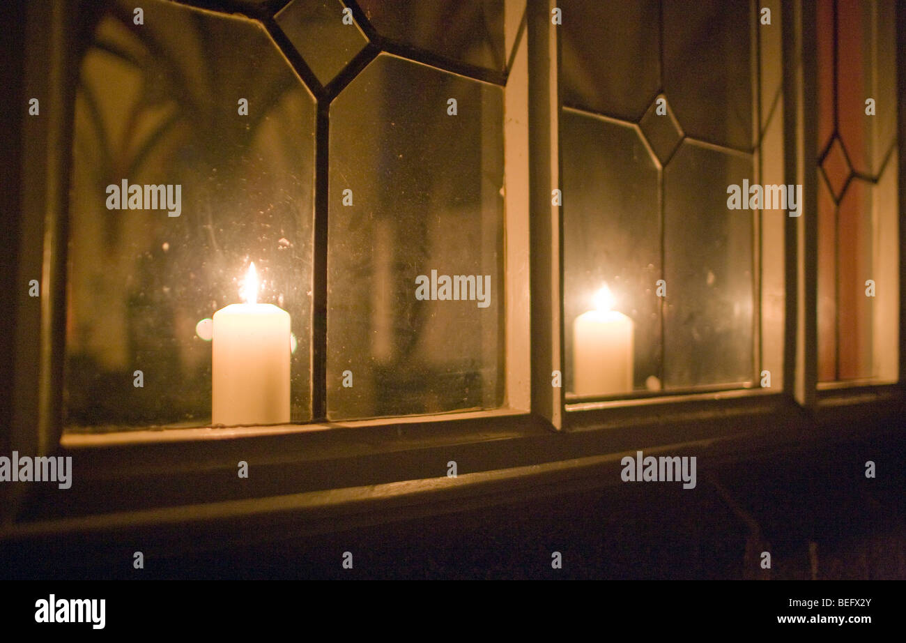 Play of light in the stained-glass windows of the abby - Stock Image