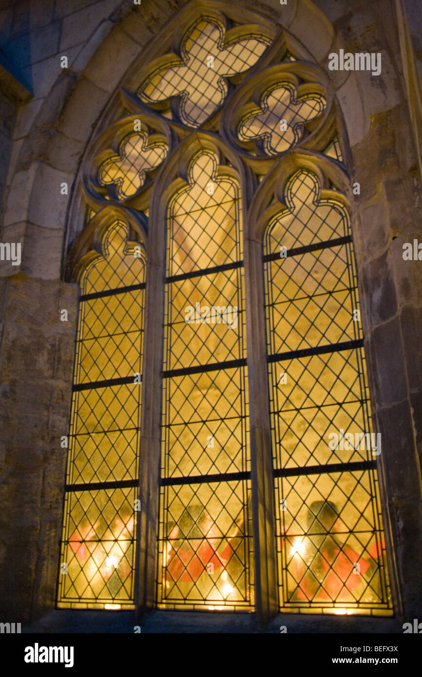 Play of light in the stained-glass windows of the abby Stock Photo